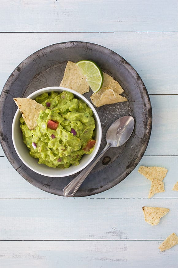This Spicy Loaded Guacamole sticks with classic ingredients and adds ...