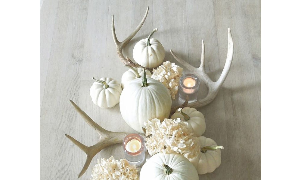 Diy antler decor for your holiday table cowgirl magazine for Antler decorations for home