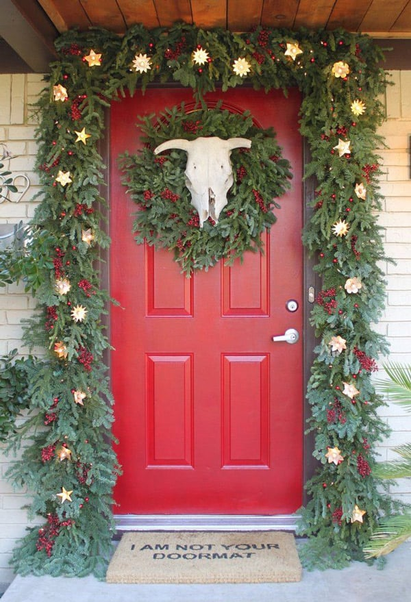 Christmas-door-with-wreath-and-cowskull