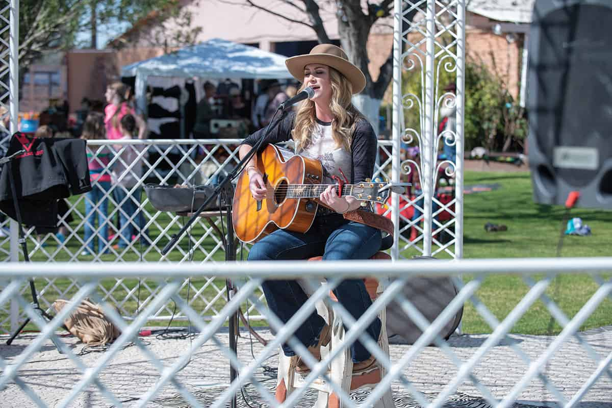 art of the cowgirl lyndsay butler singer with guitar cowgirl magazine