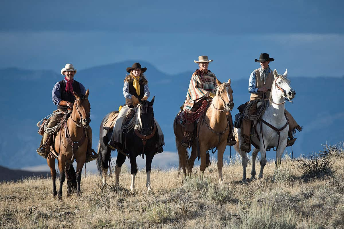 cowgirls on horses in ponchos the hideout shell wyoming cowgirl magazine